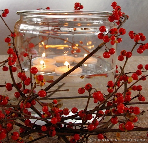 Bittersweet and floating votive candles