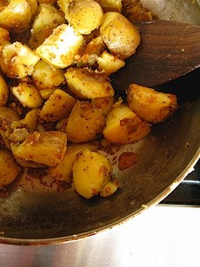 Yukon gold potatoes in pan