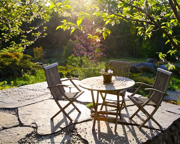 Sunlit_Terrace_with_Silverbell_Blossoms_in_May_Michaela_Medina_Harlow_thegarderseden.com